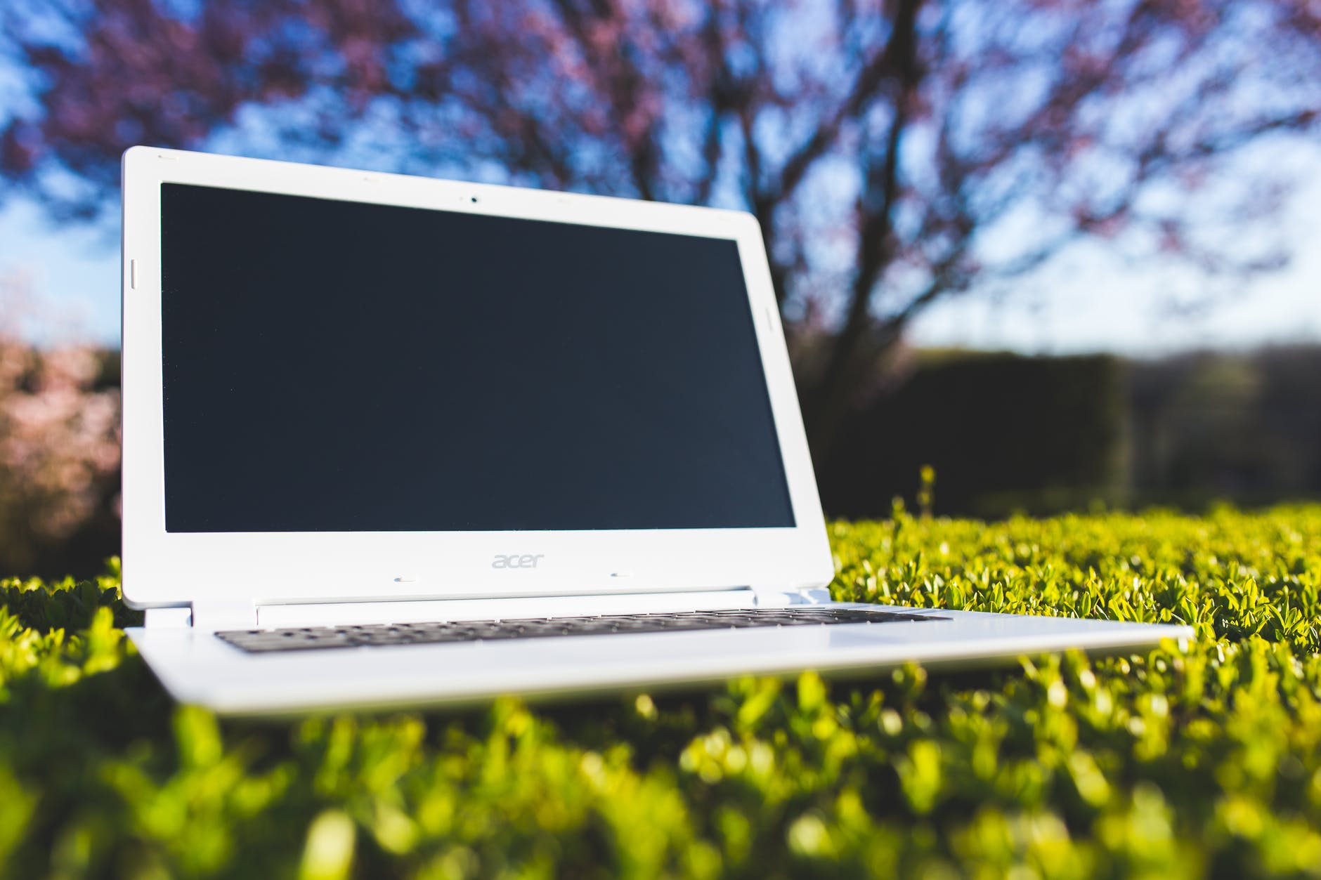"""Photo by Kaboompics .com on <a href=""""https://www.pexels.com/photo/white-laptop-on-a-green-meadow-6451/"""" rel=""""nofollow"""">Pexels.com</a>"""